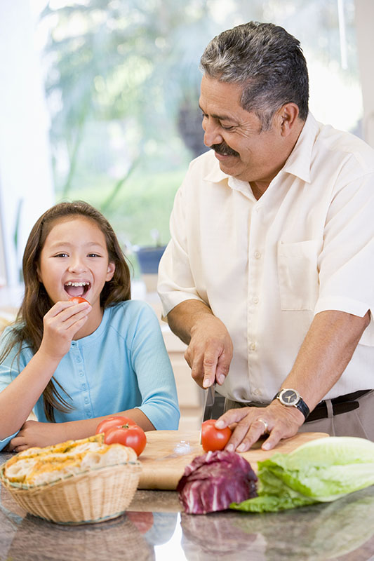 girl-with-grandfather-healthy-cooking